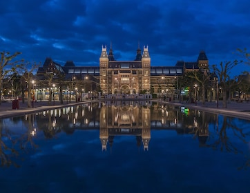 View of Rijksmuseum shining at night in Amsterdam