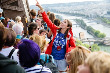 Tour guide with group on the 2nd floor of the Eiffel Tower in Paris