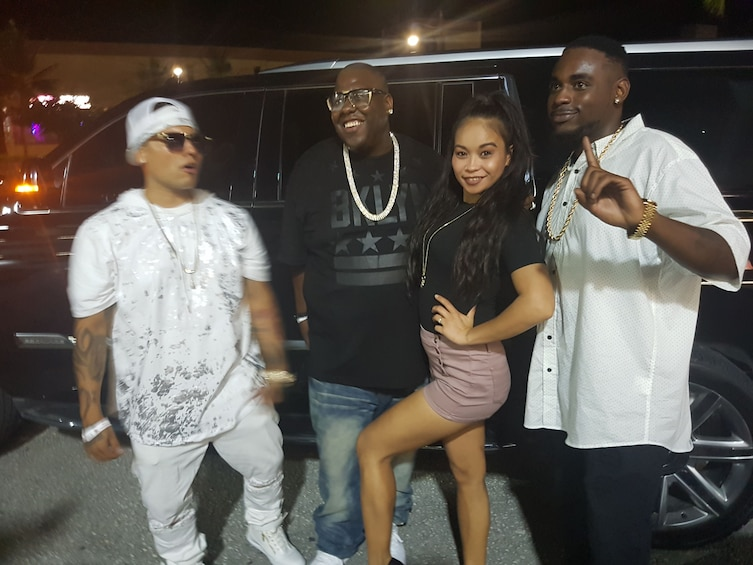 Show item 2 of 3. Group outside a limousine SUV at night in Guam