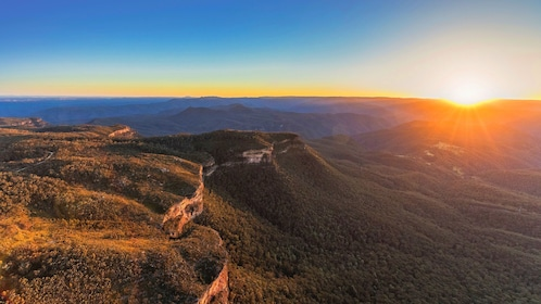 Sun sets on the horizon as seen from the Blue Mountains
