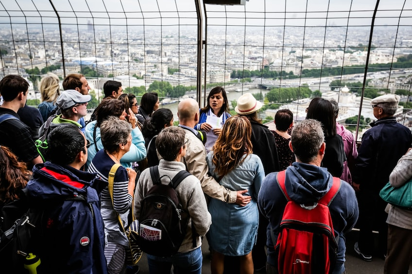 Show item 3 of 5. Tour group taking in view on Eiffel Tower in Paris