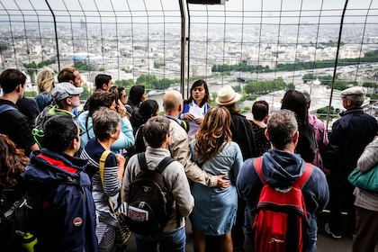 Tour group taking in view on Eiffel Tower in Paris