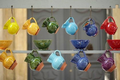 Ceramic mugs hanging from a rack