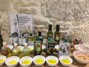 Bowls and bottles of Olive oil