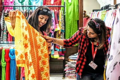 Women admiring colorful fabrics in Delhi