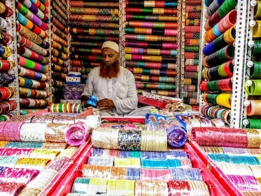 Man with rows of colorful threads at a market in Delhi