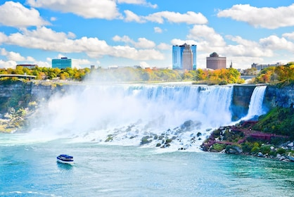 Tour boat sailing past Niagara Falls in New York