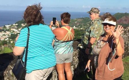 Tour group taking photos at the Leaper's Hill in Grenada