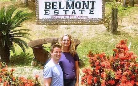 Couple stands next to the Belmont Estate sign