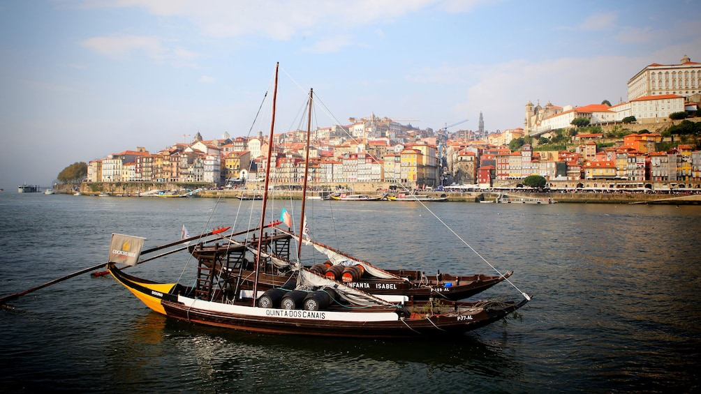 Show item 2 of 5. Boats with wine barrel in bay of Porto