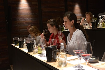 Guests sip and smell wines at Vinolia