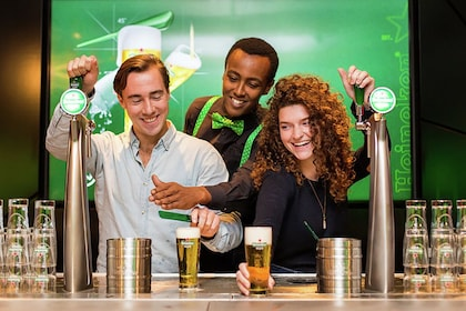 Group filling beer glasses on the Heineken® Experience tour in Amsterdam