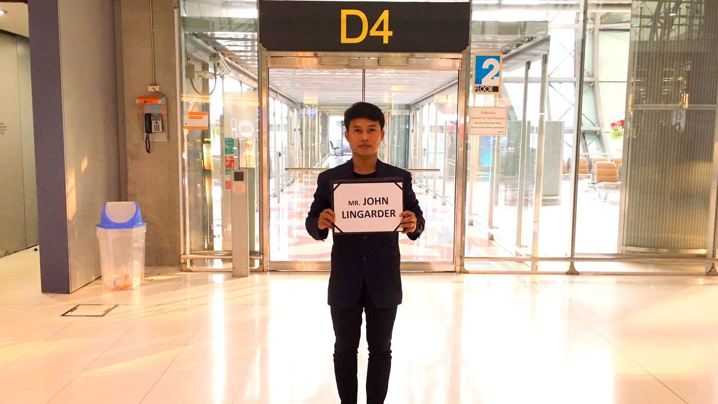 Driver waiting for a traveler at a Thailand airport
