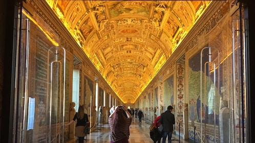 People viewing hallway at the Vatican in Rome