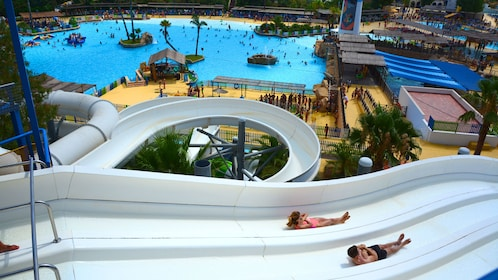 People slide down a water slide at a water park in Barcelona