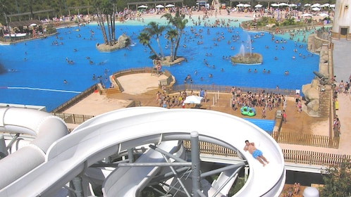Overhead view of a person on a water slide and a wave pool in Barcelona