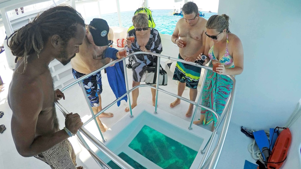 Show item 3 of 5. Group on a glass bottom boat in Barbados