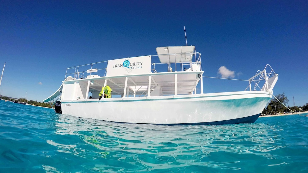 Show item 2 of 5. Landscape view of a glass bottom boat in Barbados