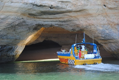 Boat entering a sea cave off the coast of Algarve