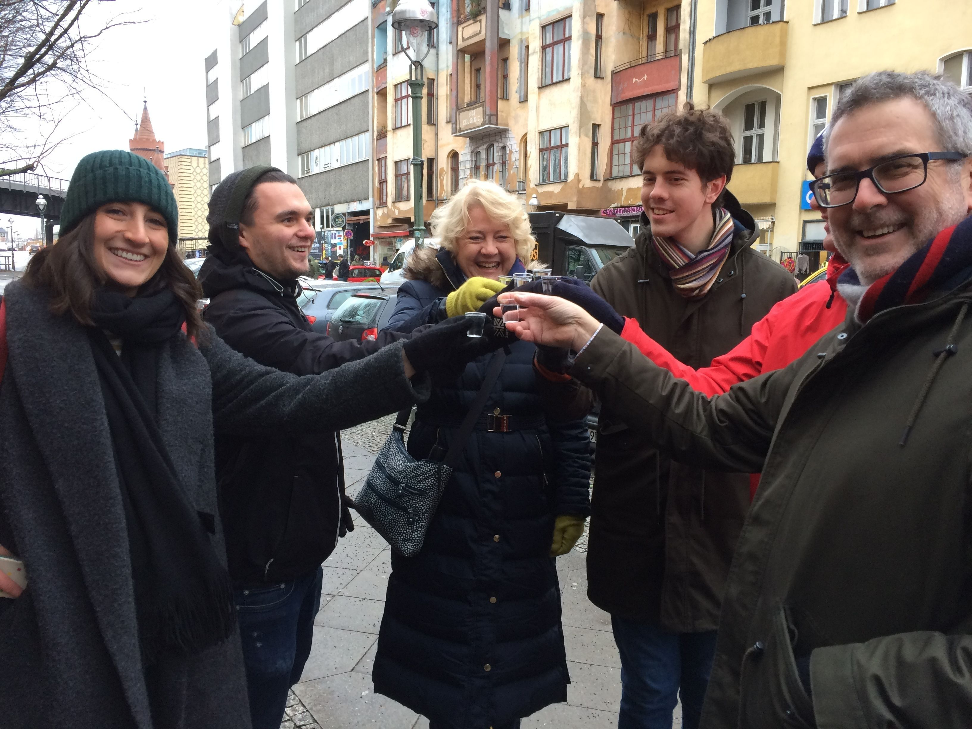 Group toasting with shots on a food tour in Berlin