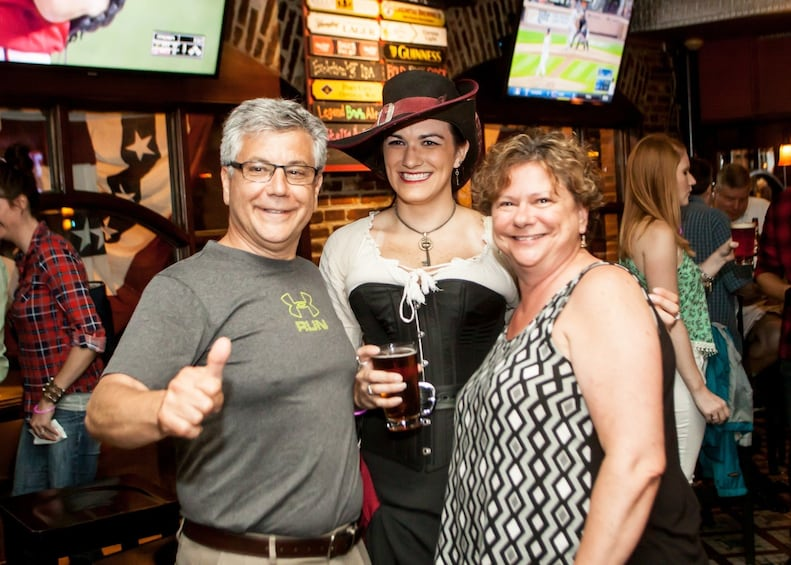 Show item 3 of 9. Group smiling on the Haunted Pub Tour in San Antonio