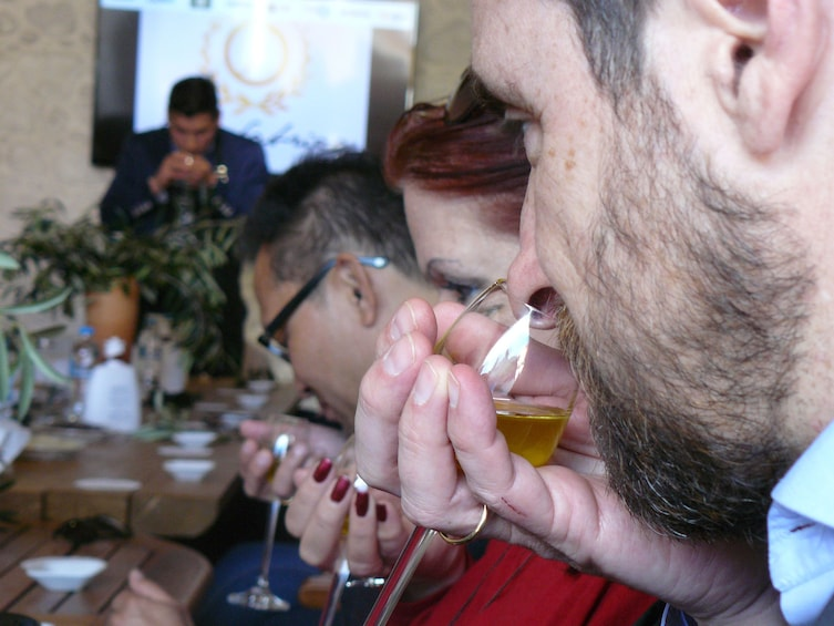 Show item 1 of 4. People sniffing olive oil in Corfu, Greece