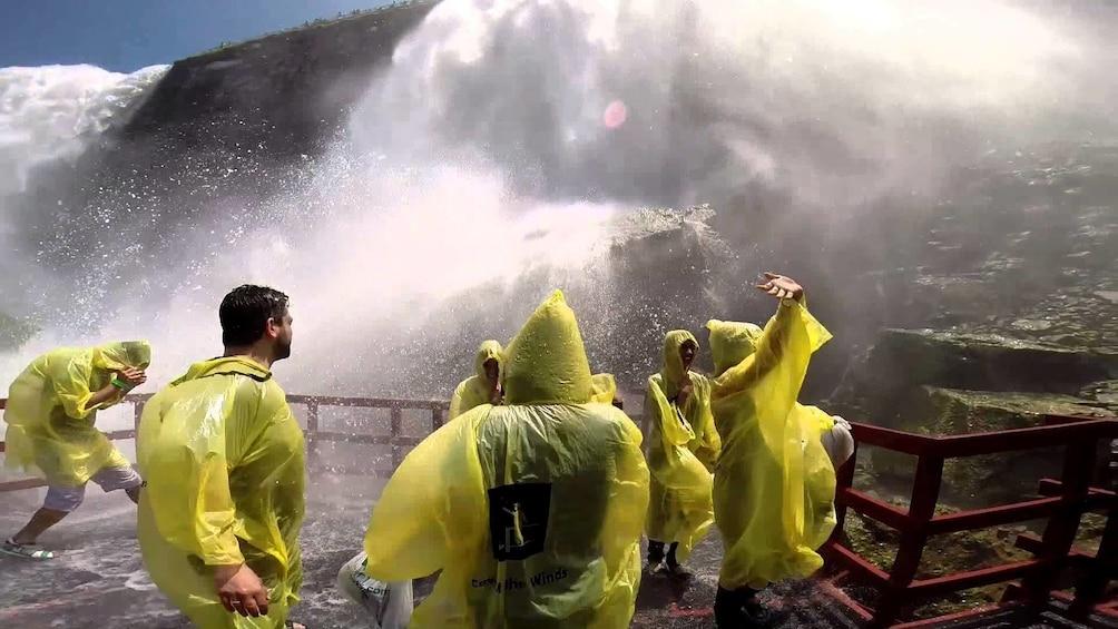 Show item 4 of 4. Group wearing yellow ponchos enjoying the Canadian side of Niagara Falls