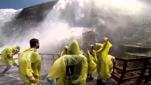 Group wearing yellow ponchos enjoying the Canadian side of Niagara Falls