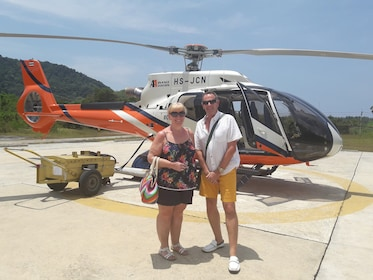 Couple next to helicopter in Phuket