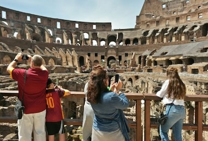 Group touring the inside of the Colosseum in Rome