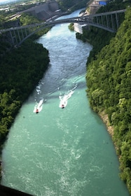 Jet boats under a bridge on the Niagra River