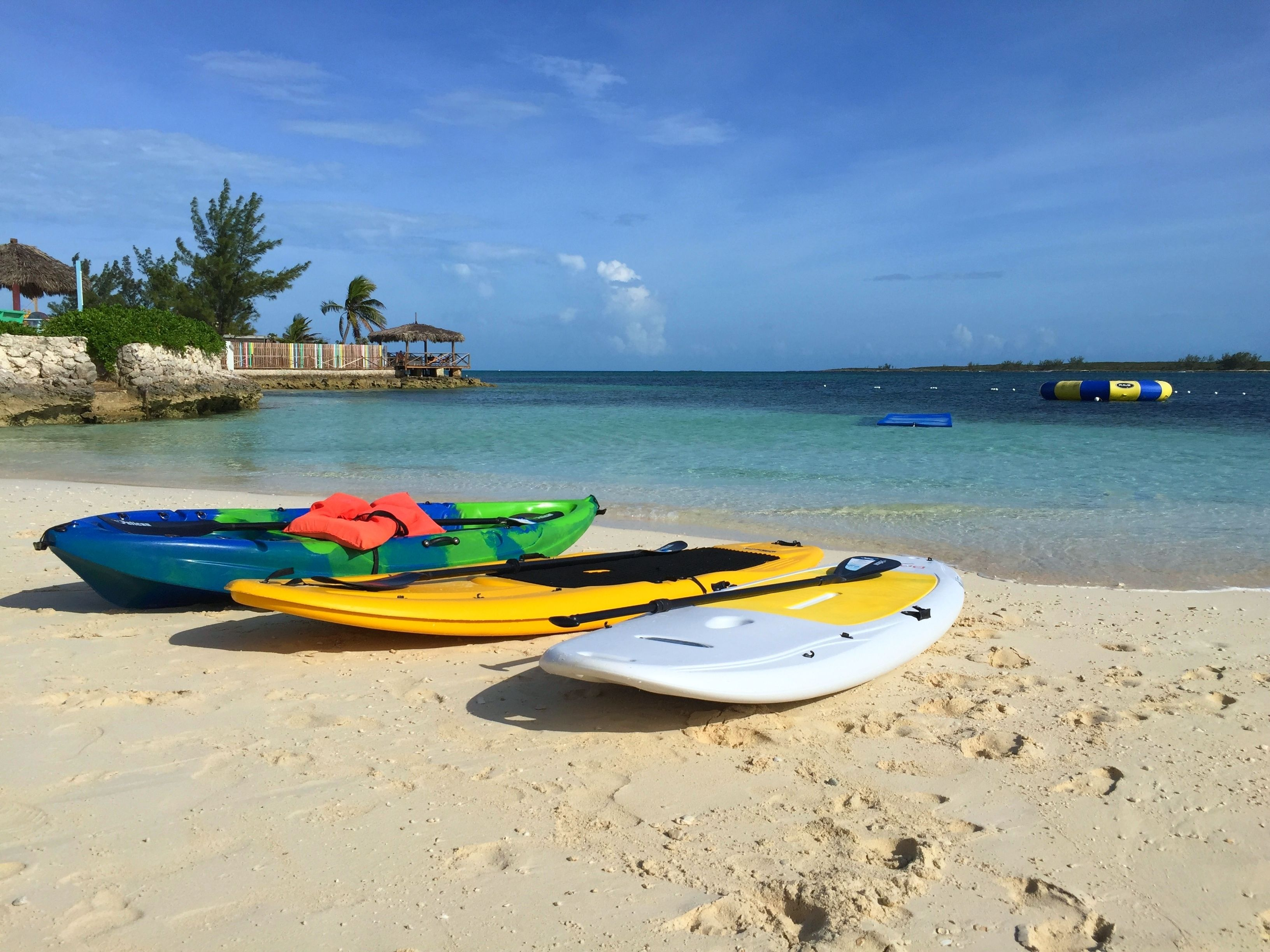 Kayaks on the beach on Pearl Island in Bahamas