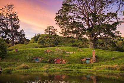 Sunset over houes and lake in Hobbiton, New Zealand