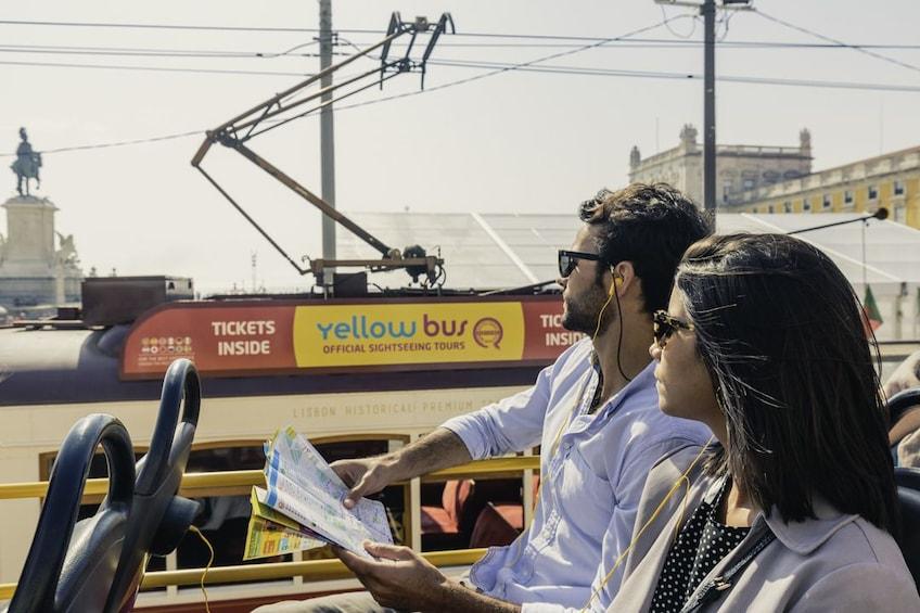 Couple on a bus tour in Lisbon