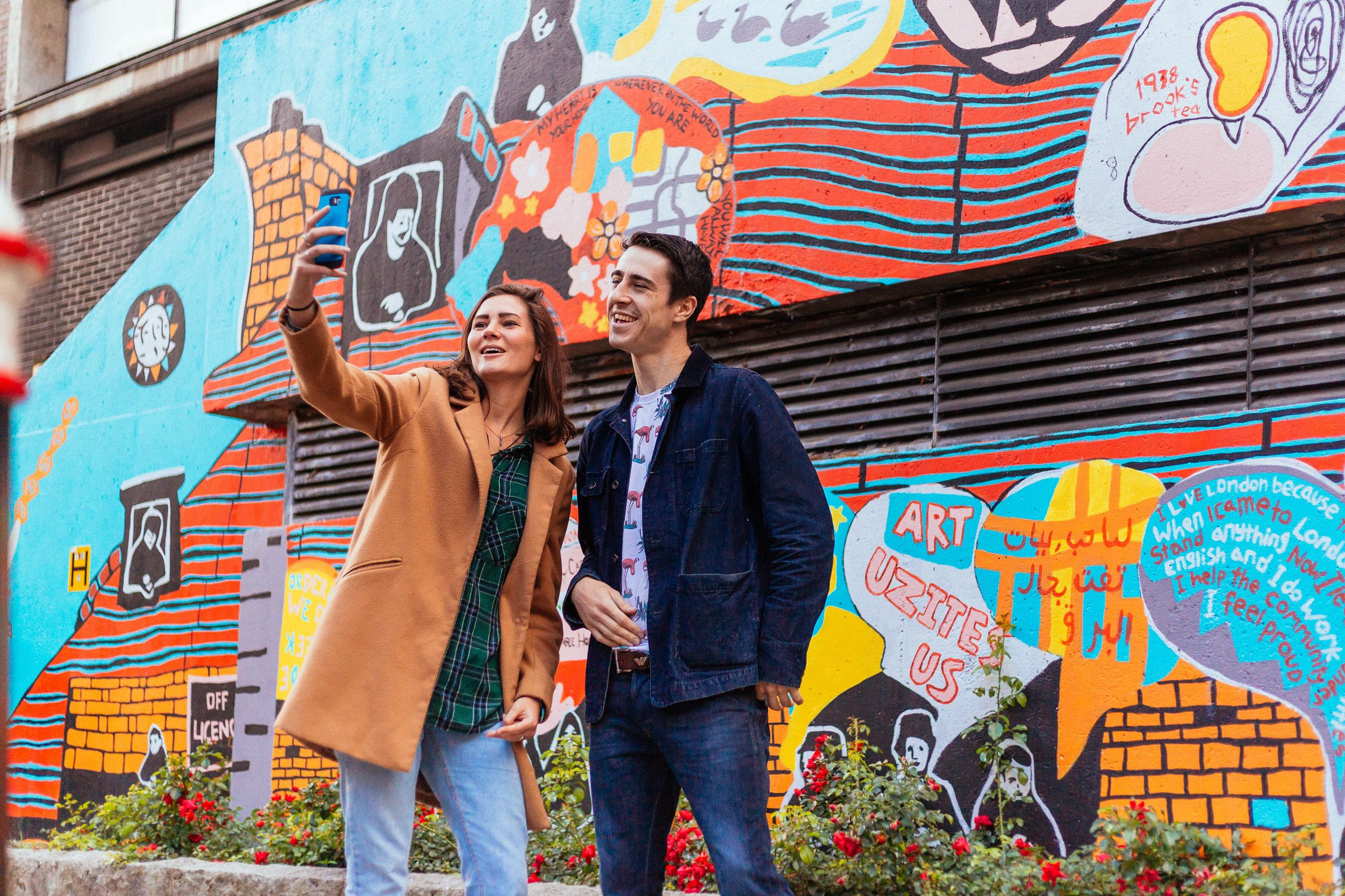 Couple takes a selfie in the Urban Jungle of London