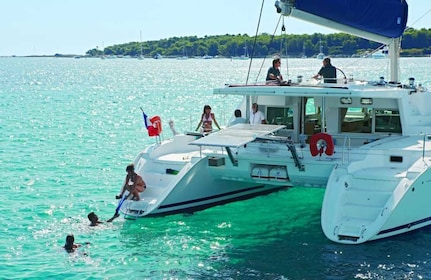 Guests enjoying their time on a luxurious catamaran vessel in Kona