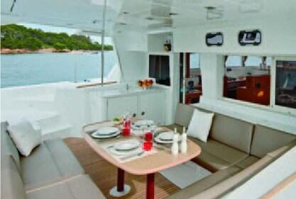 Dining area aboard the Hawaii Nautical yacht