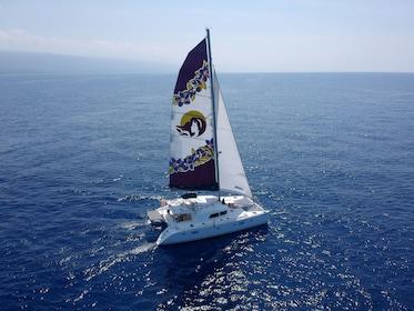 Serene views of a yacht sailing along the Kona Coast
