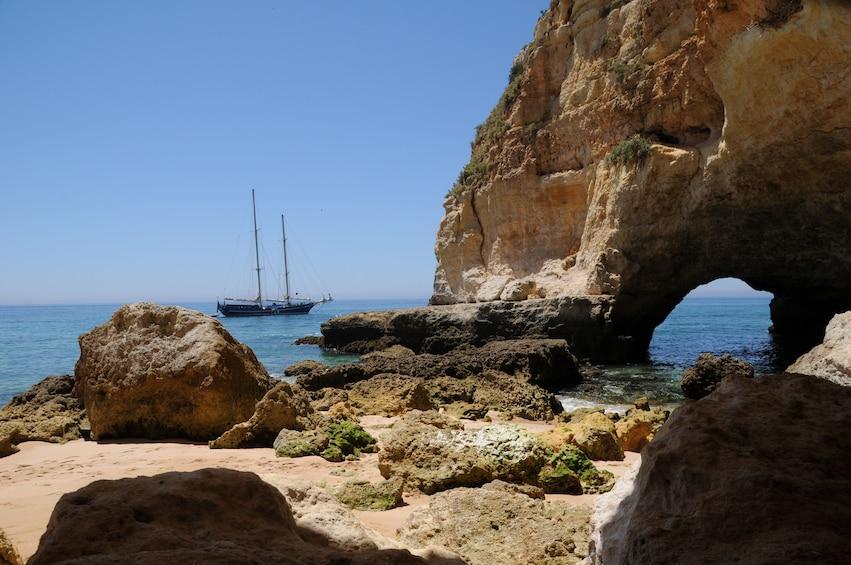 Show item 3 of 7. Boat sailing along the Algarve Coastline