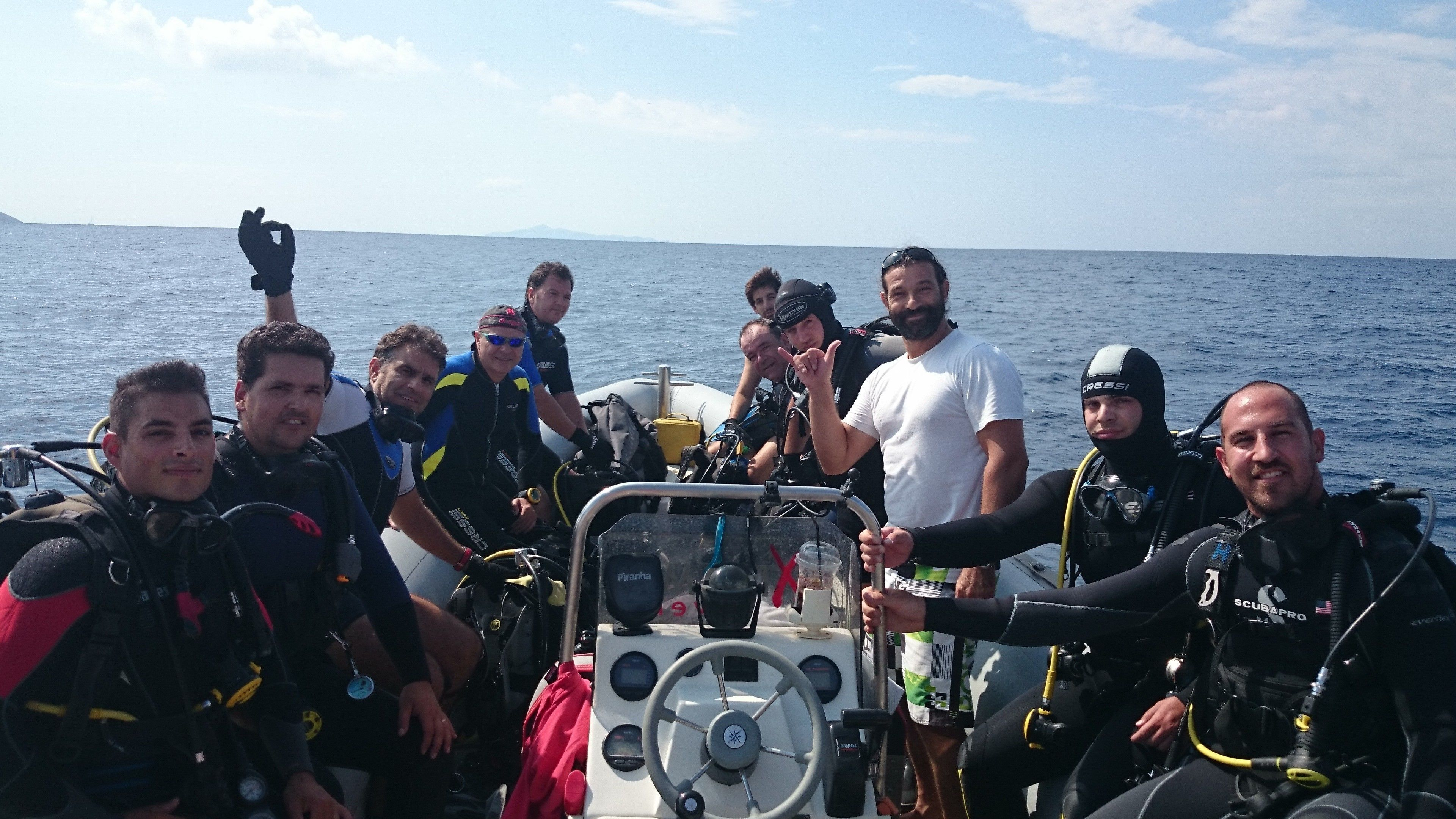 SCUBA diving group on the bow of a boat