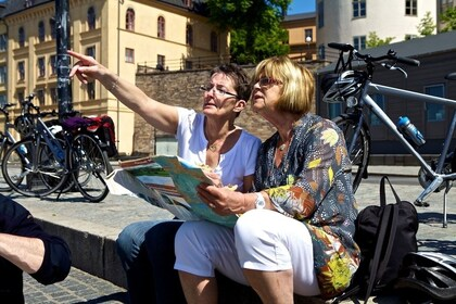 Women consulting a map while sightseeing in Stockholm