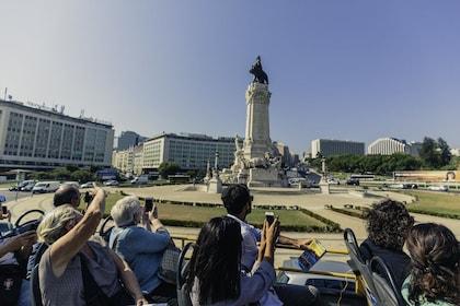 Double decker bus tour going through the Lisbon District