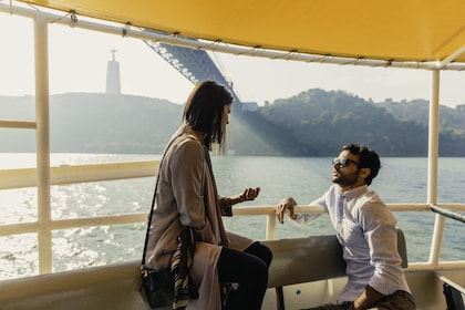 Couple on a boat tour in Lisbon