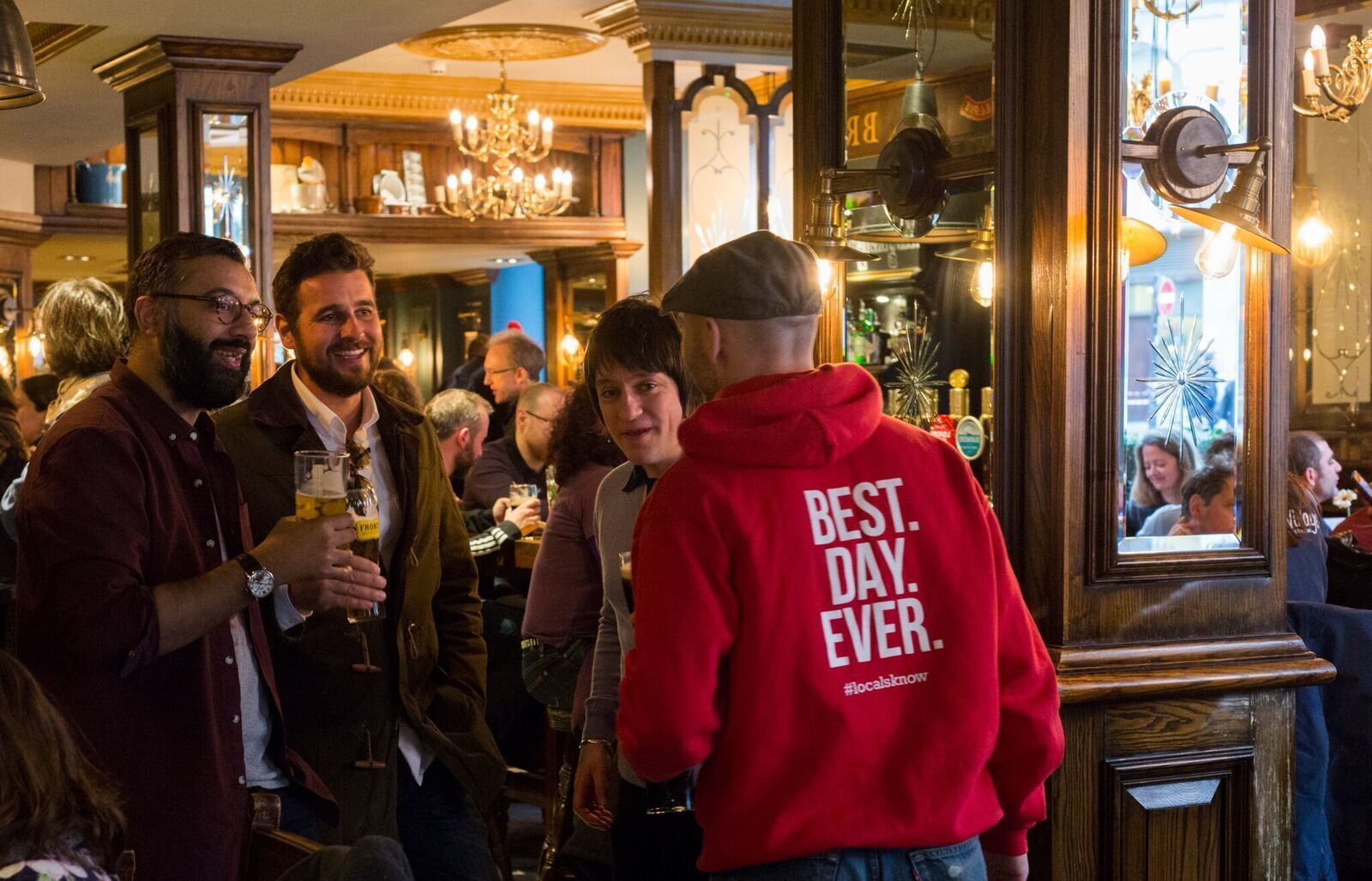 Tour guide with group at a pub in London