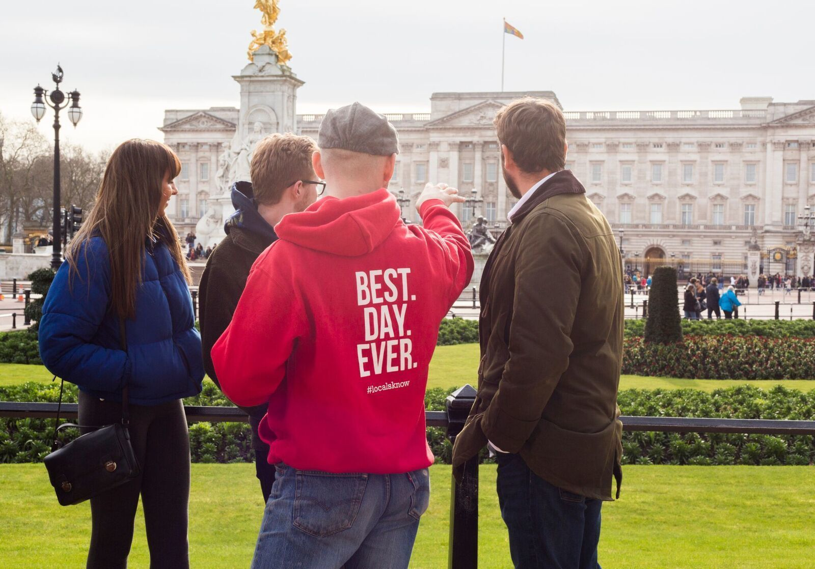 Tour guide with group in London