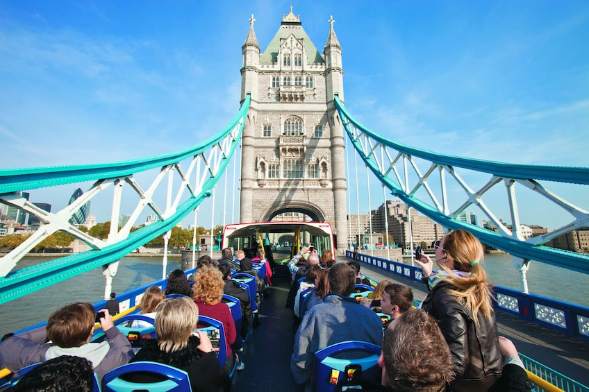Show item 1 of 6. Bus driving across the Tower Bridge in London