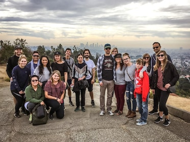 Hiking group with a view of the city in the background in LA