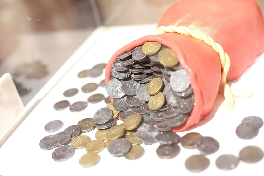 Show item 5 of 9. Realistic chocolate coins at Art Of Chocolate Museum in Hong Kong