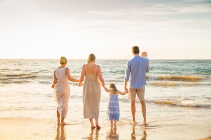 Gorgeous family photoshoot along the beach at sunset with a local photographer in Maui