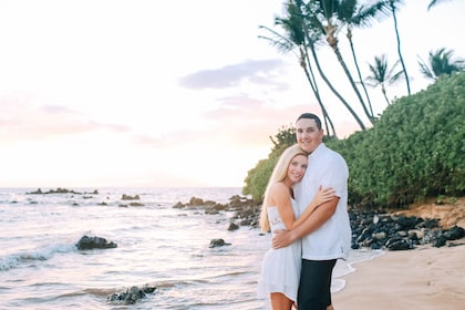 Couple on a photoshoot on the beach at sunset with a local and professional photographer in Maui